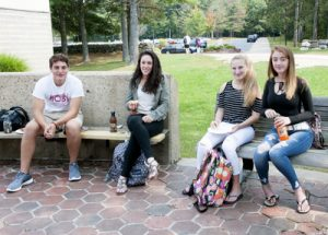 Four students sitting in the courtyard