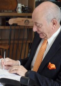 President Dr. Daniel M. Asquino signs CEOs Against Stigma Campaign